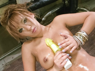 Japanese av model Hina Maeda in gold lame takes off and taunts her funbags